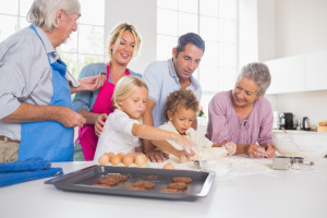 Family preparing biscuits together in the kitchen